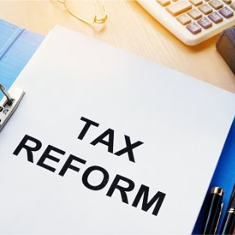​folder and documents about tax reform